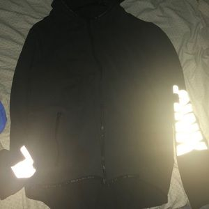 Black reflective zip up sweater